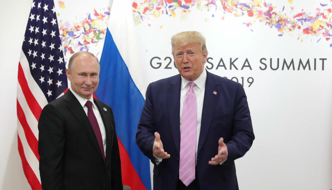 Russlands president Vladimir Putin og USAs president Donald Trump under fjorårets G20-toppmøte i Osaka, Japan.
