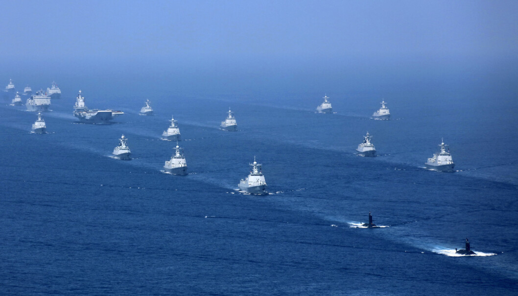 OMSTRIDT: Bildet fra 12. april 2018 er gitt ut av det statlige, kinesiske nyhetsbyrået Xinhua, og viser kinesiske marinefartøy i forbindelse med en øvelse i Sørkinahavet.
