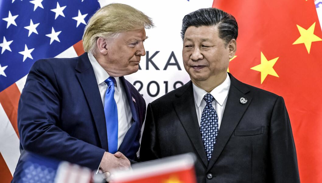 Donald Trump hilser på Kinas president Xi Jinping under G-20 møtet i Japan i 2019.