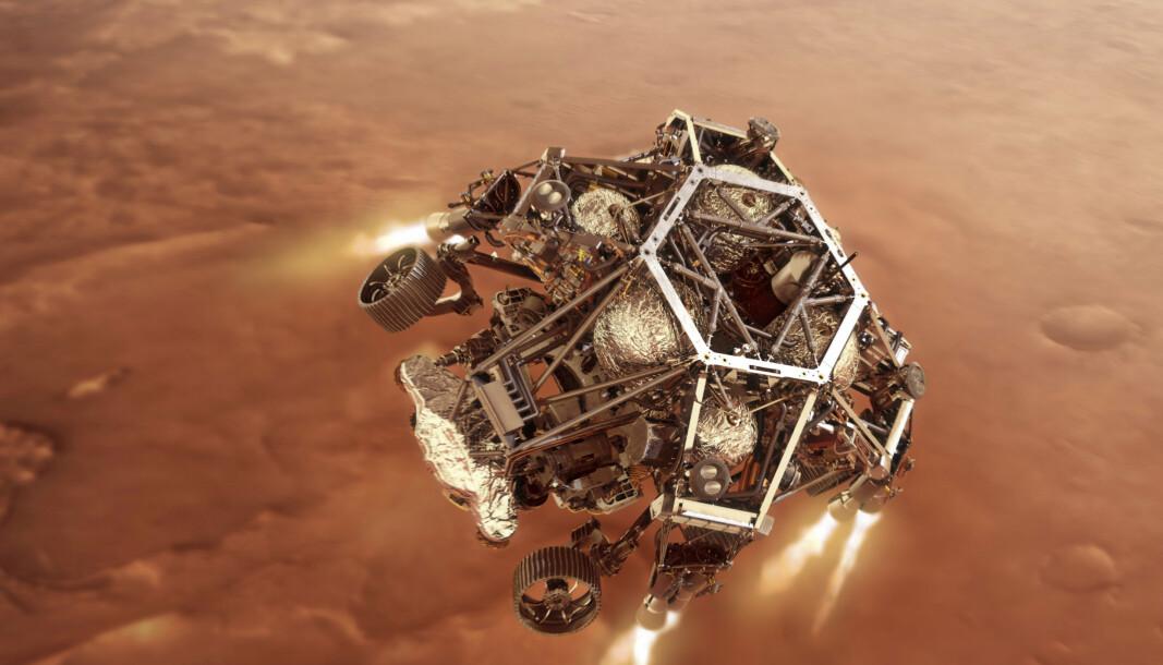 En digital illustrasjon fra Nasa viser hvordan Perseverance-landingsfartøyet antenner motorene idet den nærmer seg Mars' overflate.