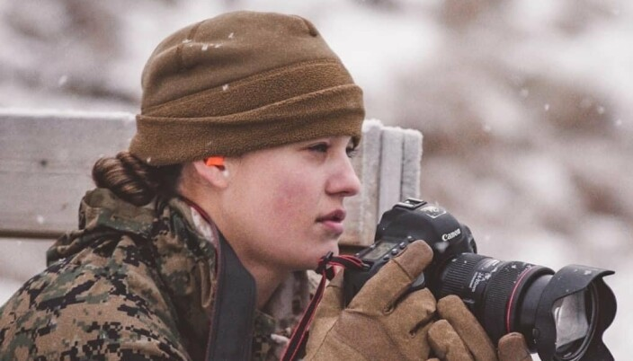 PHOTO SKILLS: Kayla L. Olsen while working in Northern Norway, where the US Marine Corps is currently training.