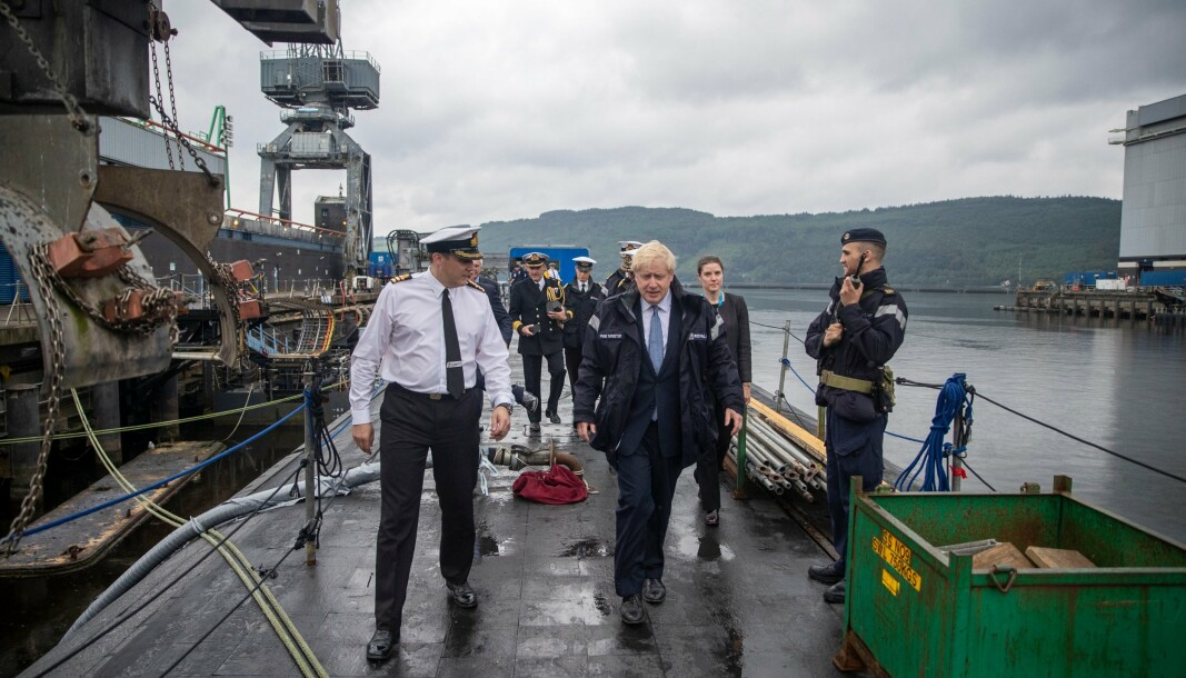 SUBMARINE VISIT: UK Prime Minister Boris Johnson visits the HMNB Clyde in 2019, where he was given a tour of one of the country's four nuclear-powered submarines of the Vanguard class, which is based there and equipped with Trident D5 nuclear missiles.
