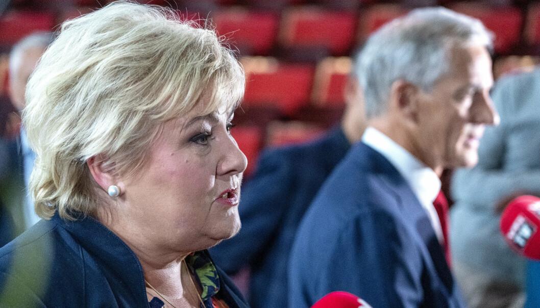 I DUELL: Statsminister Erna Solberg og Ap-leder Jonas Gahr Støre etter torsdagens statsministerduell i Trondheim. Veteranpolitikk var ett av temaene.