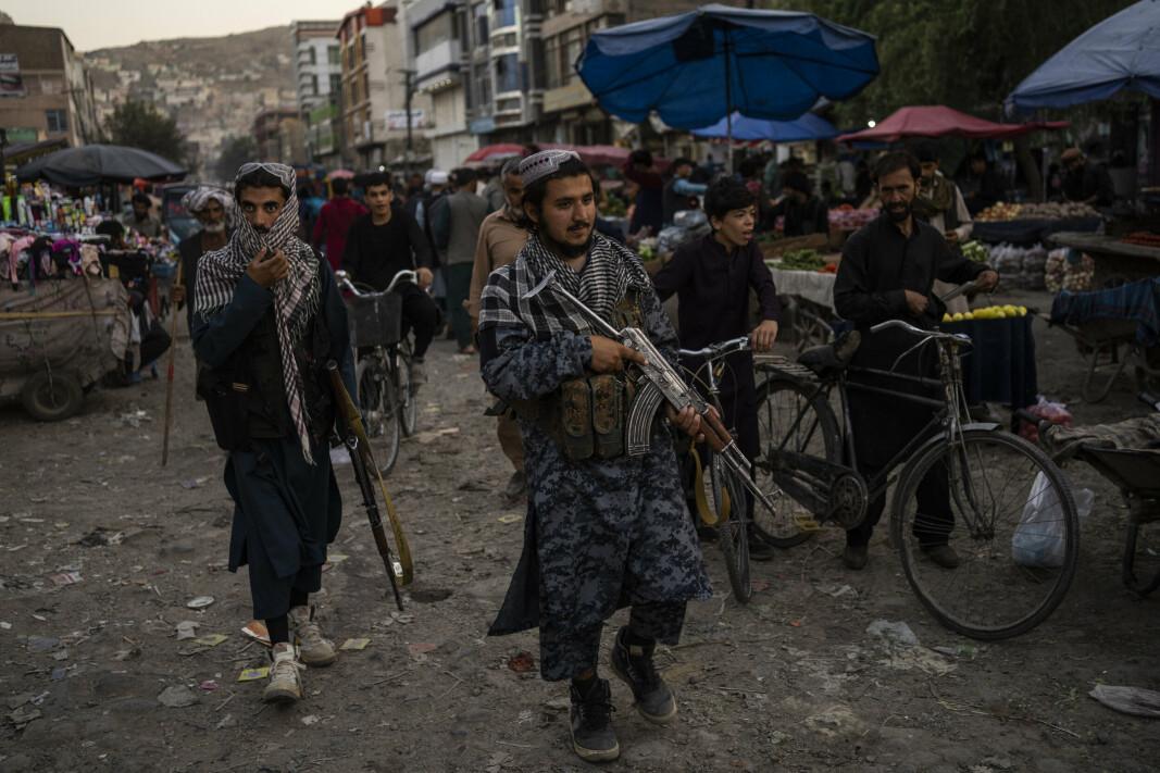 KABUL: Taliban-soldater patruljerer gatene i gamlebyen i Kabul.
